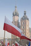 Poland, Krakow, Polish Flags and Towers of St Mary Church Royalty Free Stock Photography