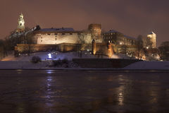 Poland, Krakow, Snow Covered Wawel Royal Castle Li Royalty Free Stock Photos