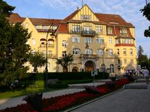 Poland, Kudowa Zdroj - June 18, 2018: View of the resort theater and flower beds at sunset stock photography