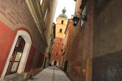 Poland, a lane in the old city of Warsaw,. Ancient church Royalty Free Stock Photos