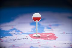 Poland marked with a flag on the map.  stock photography