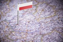 Poland marked with a flag on the map.  stock photo