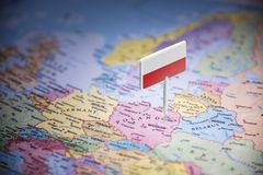 Poland marked with a flag on the map.  stock image