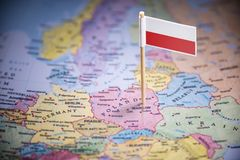 Poland marked with a flag on the map.  stock images