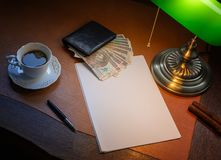 Poland money, Zloty, on a stylish desk lit with a banking lamp. Polish money, Zloty, on a stylish desk lit with a banking lamp stock photos
