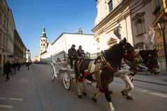 POLAND -One of the streets in historical center of Krakow. Royalty Free Stock Images