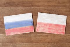 Poland and Russia flag, concept cooperation friendship on wood background. Poland and Russia flag, concept cooperation friendship competition on wood background Stock Photo