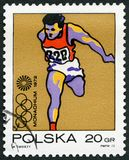 POLAND - 1971: shows Runner, Olympic Rings and Motion Symbol, series 20th Olympic Games, Munich. POLAND - CIRCA 1971: A stamp printed in Poland shows Runner Royalty Free Stock Photography