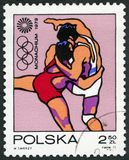 POLAND - 1971: shows Wrestling, Olympic Rings and Motion Symbol, series 20th Olympic Games, Munich. POLAND - CIRCA 1971: A stamp printed in Poland shows Stock Image