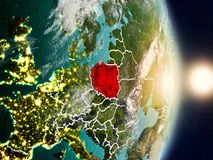 Poland during sunrise. Highlighted in red on planet Earth with visible country borders. 3D illustration. Elements of this image furnished by NASA Royalty Free Stock Images