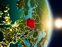 Poland during sunrise. Highlighted in red on planet Earth with visible country borders. 3D illustration. Elements of this image furnished by NASA Stock Photography