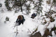 Poland, Tatra mountains, 03.11.2017, Guy and a girl climb to a royalty free stock photo