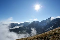Poland - Tatry - Sunshine. Stunning strong sunshine on the sky in the Tatry mountains, Poland royalty free stock photo