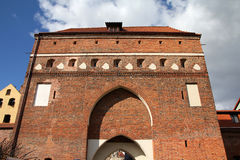 Poland - Torun. City divided by Vistula river between Pomerania and Kuyavia regions. Old town fortification - the gate. The medieval old town is a UNESCO World royalty free stock photo