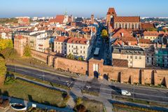 Poland. Torun old city. Aerial view. Torun, Poland. Old city with Medieval Gothic Cathedral of St. John, town hall clock tower, churches, defensive wall and city royalty free stock photography