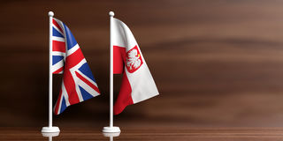 Poland and UK flags on wooden background. 3d illustration Stock Photography