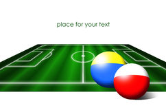 Poland and ukraine flag balls on soccer field Stock Photography