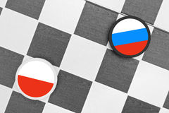 Poland vs Russia. Draughts (Checkers) - Poland vs Russia royalty free stock image