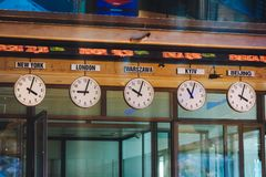 Warsaw Stock Exchange. Poland, Warsaw. August 17, 2018. Clocks display time from various time zones at Warsaw Stock Exchange WSE, GPW royalty free stock image