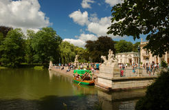 Poland - Warsaw,July 2016:Pond, Palace on the water and tourists Royalty Free Stock Photo