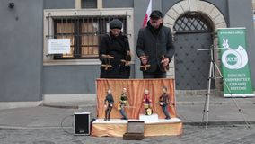 POLAND, WARSAW 9-11-2018: Performance. Puppets plays instruments on the little stage. People control the marionettes stock video footage