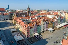 Rynek Market Square in Wroclaw, Poland. Poland, Wroclaw. Market Square Rynek with old historic tenements, gothic city hall and outdoor restaurants. Aerial view Royalty Free Stock Photo