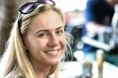 A poland young woman, 24 years, looking camera with sunglasses on forehead, smiling, outdoors. Portrait of a poland young woman, 24 years, looking camera with royalty free stock images