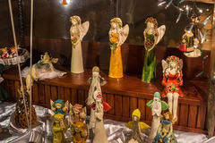 POLAND, ZAKOPANE - JANUARY 03, 2015: Souvenir figurine of angels in a shop window in Zakopane. Stock Photos