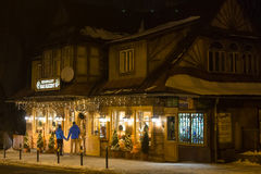 POLAND, ZAKOPANE - JANUARY 03, 2015: Traditional wooden restaurant on the street in Zakopane in the Christmas decoration. Town known as the winter capital of Royalty Free Stock Image