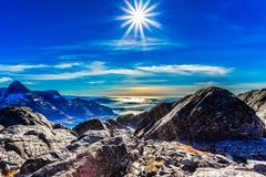 Polar arctic greenlandic sun in its zenith over the fjord and m stock images