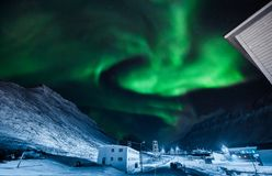 The polar arctic Northern lights aurora borealis sky star in Norway Svalbard in Longyearbyen city moon mountains. The polar arctic Northern lights aurora royalty free stock photo