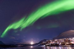 Polar arctic Northern lights aurora borealis sky star in Norway Svalbard in Longyearbyen city travel mountains. The polar arctic Northern lights aurora borealis royalty free stock photo