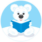 Polar bear cub reading a book Royalty Free Stock Photo