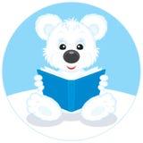 Polar bear cub reading a book Royalty Free Stock Photo
