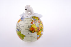 Polar bear on globe. On a white background stock images