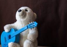 A polar bear with guitar on black background. Polar bear with guitar toys stock image