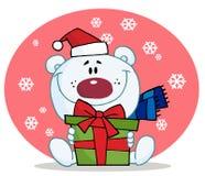 Polar bear holding a gift Stock Image