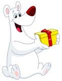 Polar bear holding gift Royalty Free Stock Photo