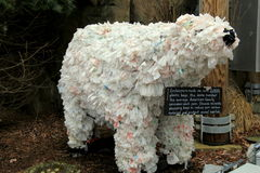 Polar bear made with plastic bags by zoo keepers, to encourage people to switch to reusable bags,Baltimore Zoo, Maryland,2015 Stock Photo