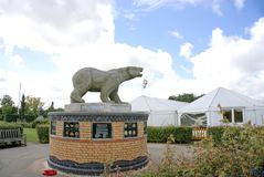 Polar bear memorial. This bear was the first memorial in The National Memorial Arboretum. It is placed by The Polar Bear Association and is a tribute to the 49th Stock Photo