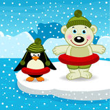 Polar bear and penguin go swimming Stock Images