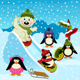 Polar bear and penguin on an ice slide Royalty Free Stock Photography