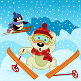 Polar bear and penguin skiing Royalty Free Stock Image