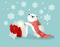 Polar bear with red scarf and gift with red bow on blue bacjground with snowflake Royalty Free Stock Images