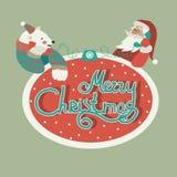 Polar bear and Santa Claus talking by phone Royalty Free Stock Photography