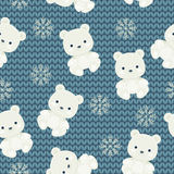 Polar bear and snowflakes over blue knitted background. Seamless Royalty Free Stock Images