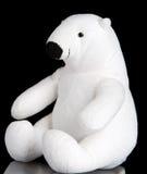 Polar bear toy. Polar bear soft toy on black background Royalty Free Stock Photos