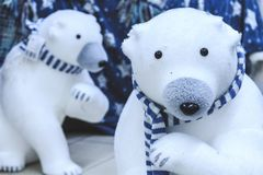 Polar bears in blue scarves. Christmas soft toys royalty free stock photography