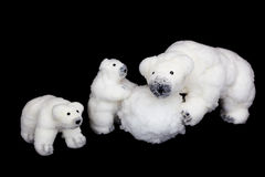 Polar bears family figurines playing with snowball Royalty Free Stock Photos