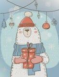 Polar christmas bear with present box Stock Image